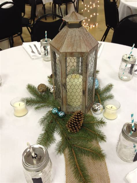 Simple winter wedding centerpiece! With a lantern in the