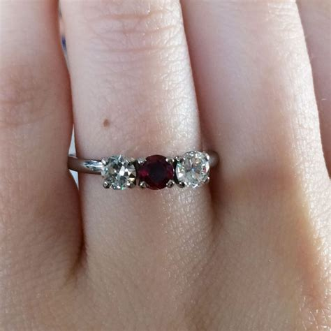 Ruby 18 25ct 18k white gold 0 60ctw and 0 25ct ruby ring