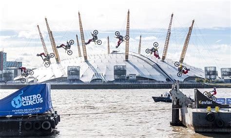 river thames jump stunt stunt motorcyclist jumps between two river thames barges