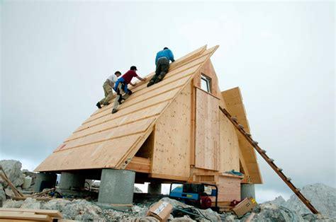 a frame building wooden a frame cabin crowns alpine mountaintop