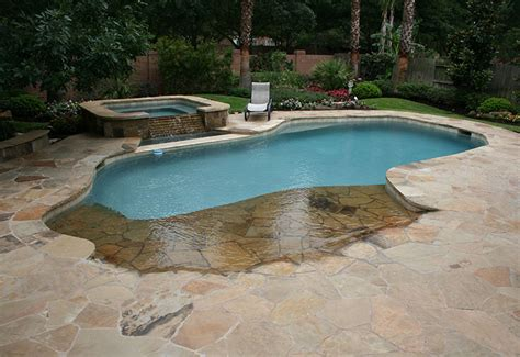 free form pool designs backyard swimming pool with beach entry and fire pit