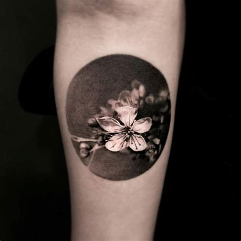 black circle tattoo black and grey style cherry blossom circle on