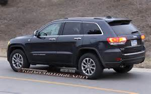 2014 jeep grand limited front view in motion