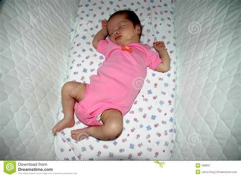 Babies Sleeping In Crib Baby Sleeping In The Crib Royalty Free Stock Photography