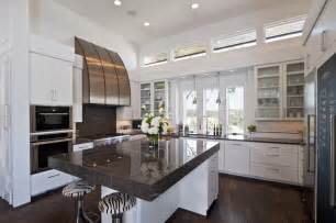 white drawers also white island in contemporary kitchen