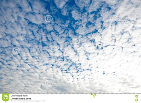 pattern of small white clouds crossword many little white clouds in summer blue sky royalty free
