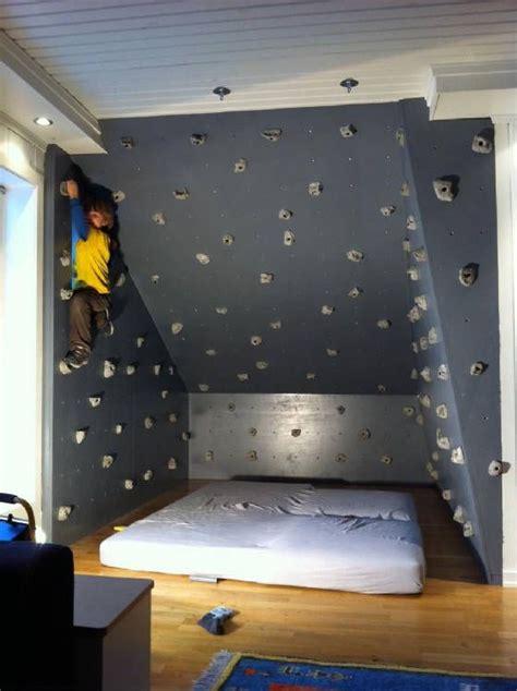 rock climbing bedroom kids boulder wall right by matress on floor sensory
