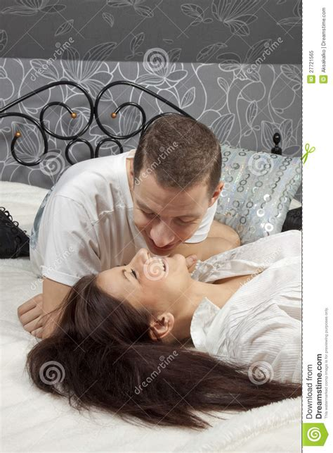 women kissing in bed man and woman kissing in the bed royalty free stock photo image 27721565