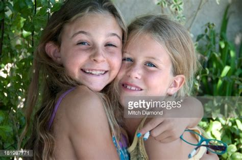 free photos of little girls youngworld collectionscom young girls together stock photo getty images