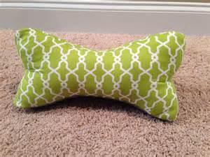 green and white bone neck pillow