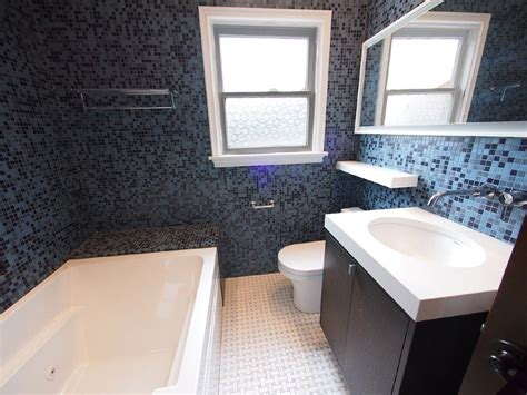 the bathroom with jacuzzi tube and glass tile walls