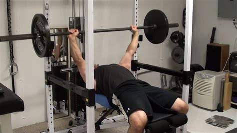 bench press safety pins chest exercise tip step riser trick for increasing pec