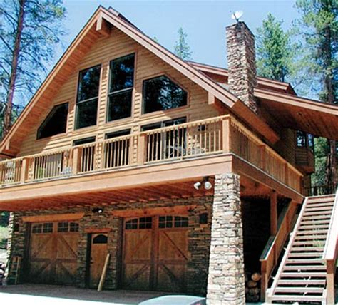log home floor plans with garage and basement image of the model c 511 our smallest chalet house plan design with tuck under garage