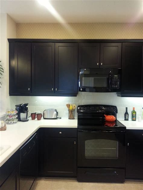 white cabinets black appliances model kitchen i chose the same cabinets in expresso
