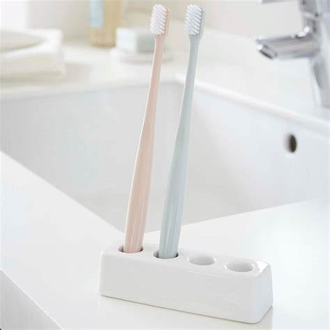 bathroom toothbrush storage yamazaki ceramic toothbrush holder the container store