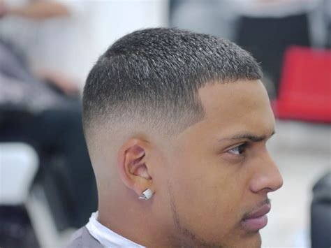 mid top fade four on top mid low fade with light thin beard cut by fee
