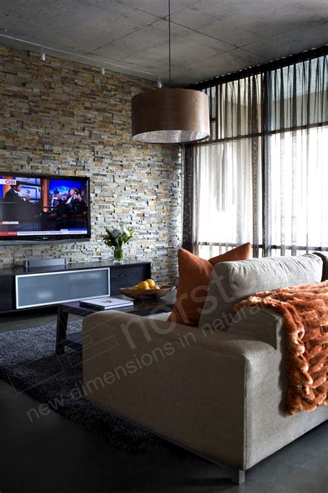 stone wall in living room how to install a tv on a stacked stone wall norstone blog