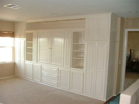 White entertainment center with beadboard doors ? Cabinet