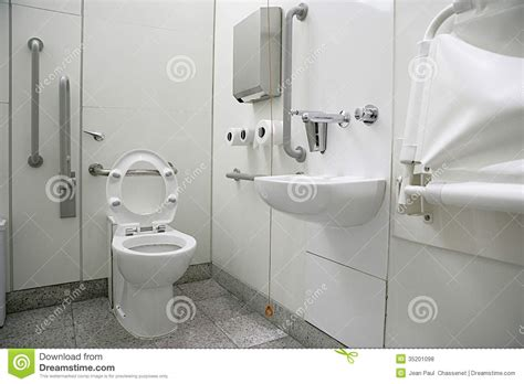 Handicapped Bathroom Designs horizontal view of a toilet interior for disabled stock