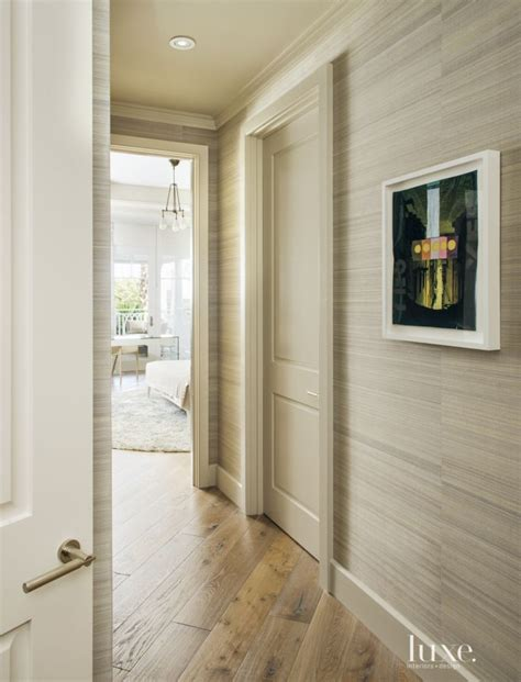 contemporary neutral hallway with wallcovering luxe