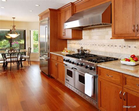 cherry cabinets combined with granite countertops and