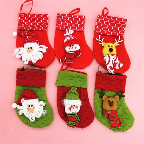 twenty five days of christmas minu stocking on a rope from crackabsral socks decoration hanging gift bag ornament snowman green colour
