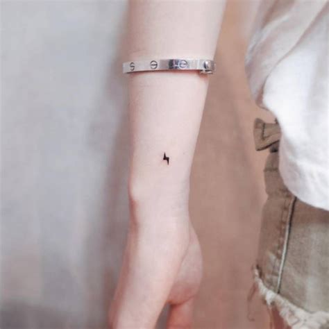 micro tattoo tiny lightning bolt on the wrist