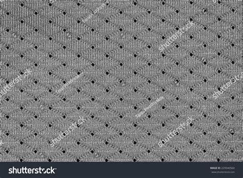 jersey hole pattern white sportswear fabric holes texture closeup stock photo
