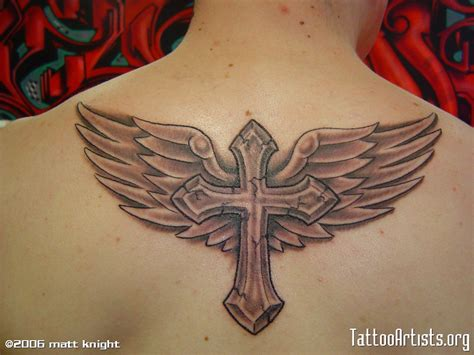 image result for cross with angel wings tattoo parkinson