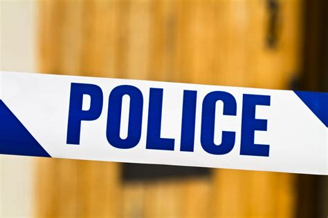 police tape masked men punch kick supermarket staff during robbery