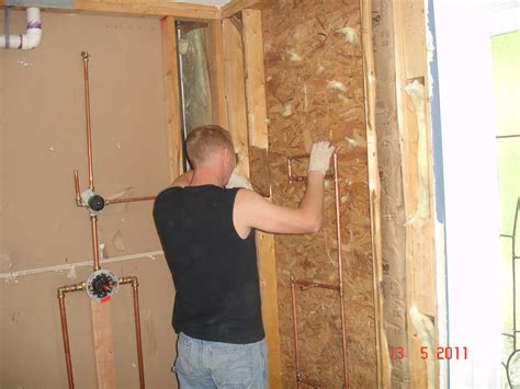 Installing Shower Plumbing by Bathroom Remodeling Services