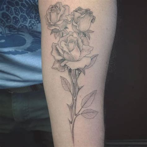 fine line style rose on the forearm