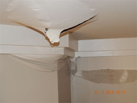 buying an old house common problems hidden costs benefits photo ceiling damage water leak images leaky roof water
