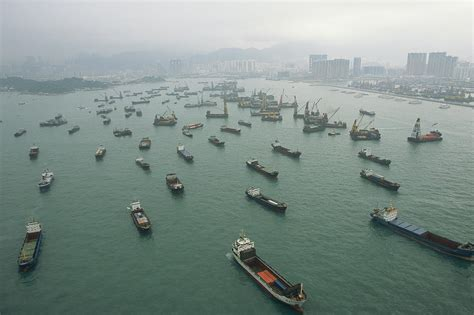boat shipping singapore container ships in hong kong harbor photograph by justin
