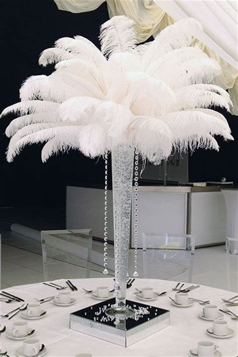 ostrich feather table centerpieces vase filled with clear or coloured gel with 25 ostrich feathers and 4