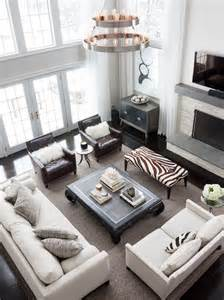 ideas living room seating pinterest: two story living room with floor to ceiling windows covered as well as