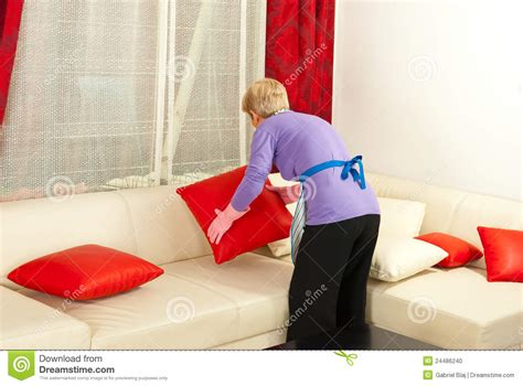 how to place pillows on a sectional woman arrange pillows on sofa stock photo image 24486240