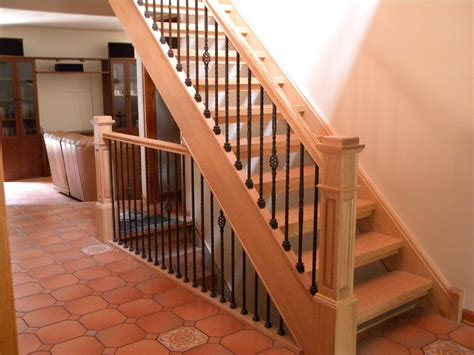 wood stair case wood stairs and rails and iron balusters wood stairs and