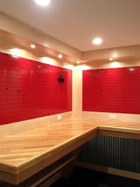 nice workbench  red metal pegboard panels