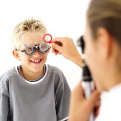 Eye Doctors Professional Checking The Of Boy