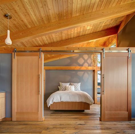 rustic bedroom doors 25 bedrooms that showcase the beauty of sliding barn doors