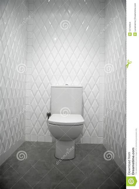 toilet   white room diamond shape tiles stock images