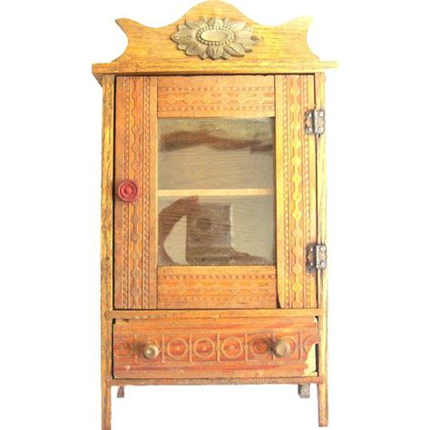 miniature doll display cabinet sold on ruby