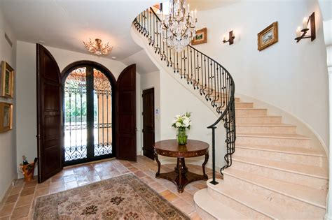 wrought iron stair railing Entry Mediterranean with arched