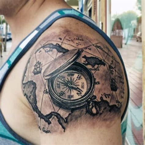 picture of upper shoulder world map tattoo with a compass