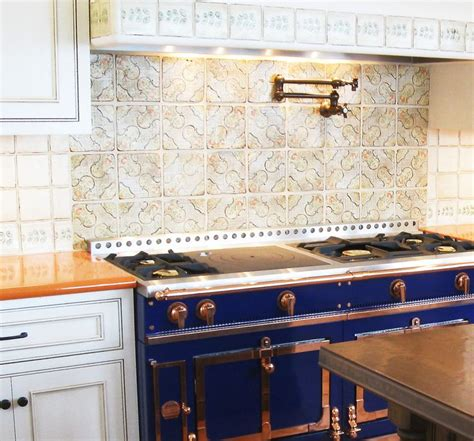 french blue and white ceramic tile backsplash orange lavastone counter with blue french range and