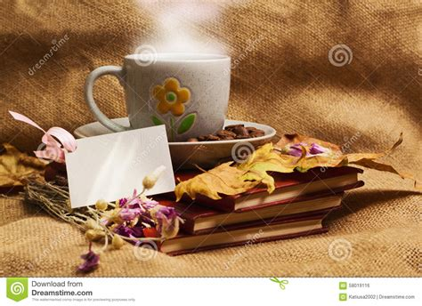 cups everlasting books the cup of coffee lying ot the books with maple leaves