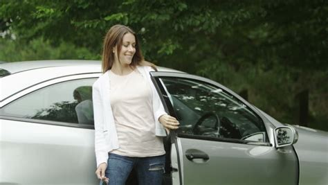 woman driver on the phone for car breakdown woman driver on notebook and car breakdown stock footage