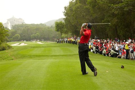 tiger woods returns  asia  energize young athletes