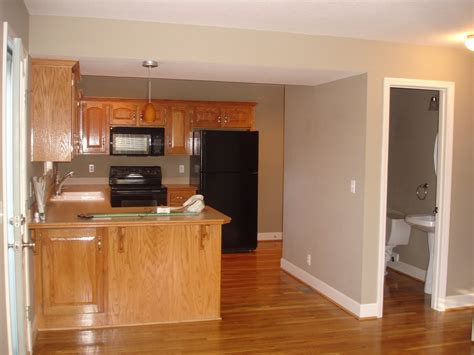 what color wood floor with dark cabinets paint color to tone down yellow oak cabinets and warm very